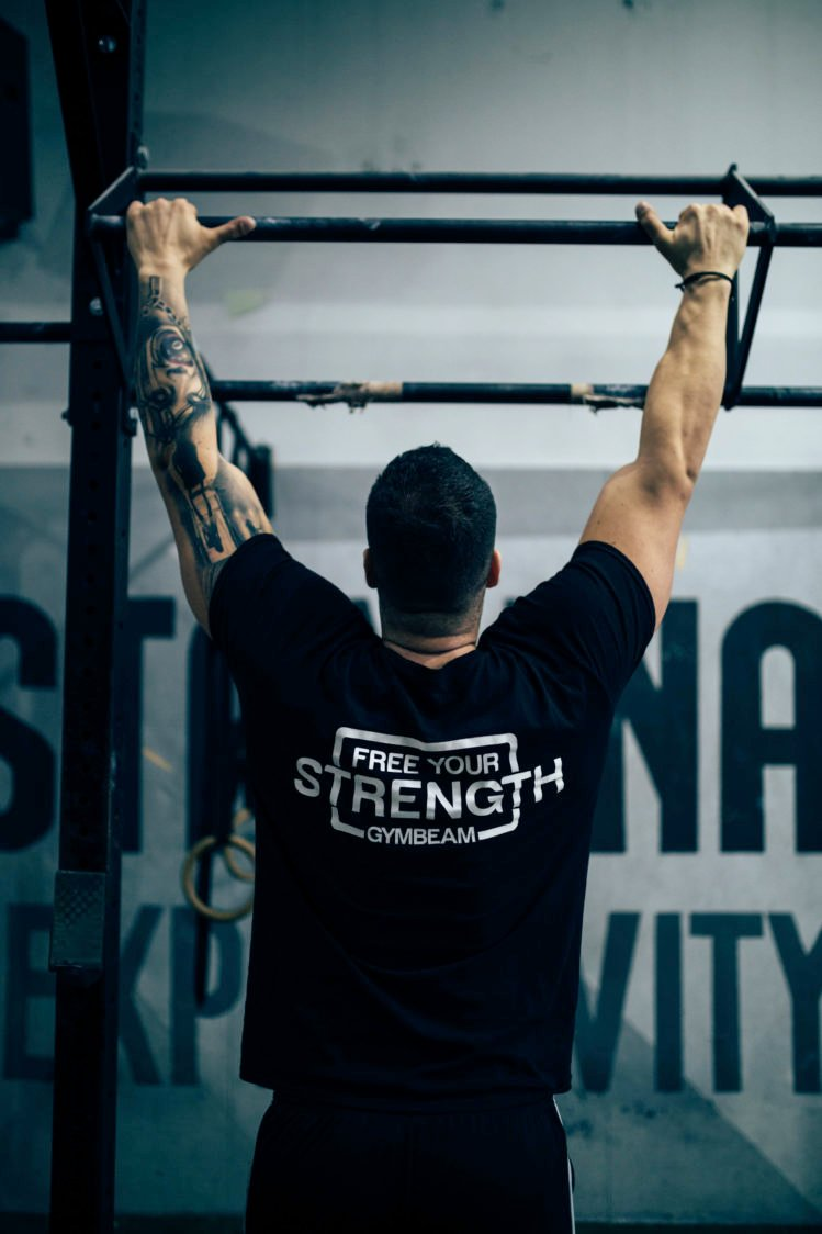 Why is it beneficial to exercise on the pull-up bar?